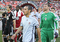 Carey Talley #8 of D.C. United and Pablo Mastroeni #25 of the Colorado Rapids lead their teams onto the field during an MLS match on May 15 2010, at RFK Stadium in Washington D.C. Colorado won 1-0.
