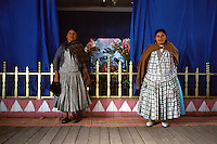 Two caretakers of a small chapel in Quispe proudly stand before their charge.