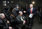 WATERBURY, CT -- 02/23/04 -- 0223TH07.04 --  Senator Chris Dodd D-Conn shakes hands with Dave Carneiro of Waterbury and Local #677 as his fellow teamsters, Joe Carneiro and Cam Boucher await their turn to greet the Senator at Teamsters Vision Center Local #677 on Baldwin Street in Waterbury Monday morning.  Senator Dodd outlined his latest plans to keep manufacturing jobs in state.  PHOTO BY TODD HOUGAS
