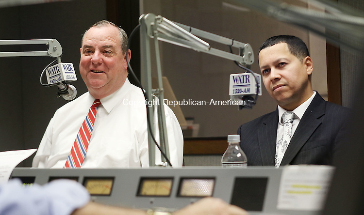 WATERBURY CT. 26 October 2015-102715SV05-From left, Democrat Mayor Neil O&rsquo;Leary, Republican mayoral candidate Jose Morales, participate in a debate on WATR radio in Waterbury Tuesday. <br /> Steven Valenti Republican-American