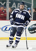 John Henrion (UNH - 16) - The University of Maine Black Bears defeated the University of New Hampshire Wildcats 5-4 in overtime on Saturday, January 7, 2012, at Fenway Park in Boston, Massachusetts.