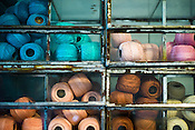 Spools of thread and other raw material of Mexican Designer, Sara Beltran is seen in her studio in Jaipur, Rajasthan, India.