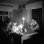 1945, April, Germany, Picture by Candle light L to R. Lt. Richard Hoorn, Robert Hallowey, Raymond Fisher