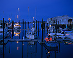 Fishing boats at marina with Christmas lights at twilight along the Southern Oregon Coast Bandon Oregon State USA
