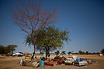 Returnees living under a tree outside of Bentiu. Thousands have returned from Khartoum and are living without water, shelter, and access to food. The flood of refugees has halted over the last week due to robberies and muders committed by the missereyi along the road between Kaduguli and Abyei. The government in Abyei says nearly 200 buses have been stopped from crossing through Abyei into South Sudan.