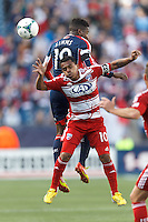 New England Revolution midfielder Clyde Simms (19) and FC Dallas midfielder David Ferreira (10) battle for head ball. .  In a Major League Soccer (MLS) match, FC Dallas (red) defeated the New England Revolution (blue), 1-0, at Gillette Stadium on March 30, 2013.