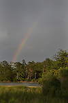 Summer storm clouds and a rainbow over College Creek at the James River along the Colonial Parkway in James City County, near historic Jamestown Virginia.  The Colonial National Historical Park (U.S. National Park Service,) is in Virginia's &quot;Historic Triangle&quot;
