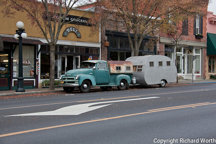 A truck and camp tailer parked on Main Street, St. Helena, in California's Napa Valley makes one wonder:  Camping trip? A home on wheels?  Or, maybe, someone's special project?
