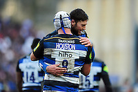 Leroy Houston of Bath Rugby celebrates his bonus-point try with team-mate Matt Banahan. Aviva Premiership match, between Bath Rugby and London Irish on March 5, 2016 at the Recreation Ground in Bath, England. Photo by: Patrick Khachfe / Onside Images