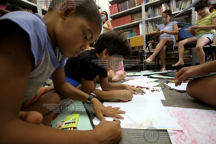 Young people attend an arts class at the Centre for Citizenship, Cultural Actions and Studies (CEACC) in the Cidade de Deus (City of God) slum in Rio de Janeiro.