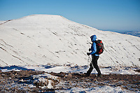 Female hiker in winter with Pen Y Fan in background, Brecon Beacons national park, Wales