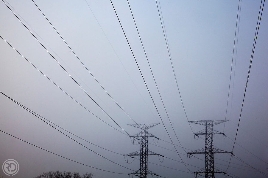 Dense fog, which had shrouded the Chicago area earlier, starts to burn off around high tension power lines in Addison, IL on March 9, 2010