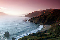 4 August 2006: Colorful pink sunset along the central California along the coast of Big Sur. Graphic,art, texture, sky, surf, sand, ocean, refelction, book.