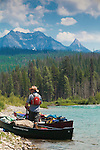 Taking a break on a canoe trip down the North Fork of the Flathead River from Canada to Columbia Falls, Montana area