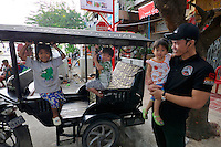 Phnom Penh, Cambodia. Kids on a tuk tuk.