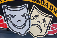 Comedy and Tragedy masks on a sign in New York City