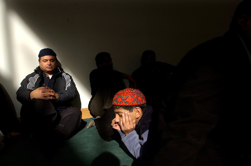 Akber Mohammad of Kenosha, Wis., and Adeel Ahmed of Huntley, Ill., pray during a special Eid-Al-Adha service, marking God's request of Abraham to sacrifice his son, at the Al-Masjid Baet-ul-Jaamay Mosque in Glen Ellyn, Ill., Friday, Jan. 21, 2005. ..