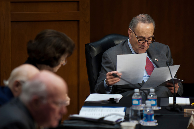 "Senator CHUCK SCHUMER (D-NY) looks over notes as members of the Senate Judiciary Committee discuss the ""Respect for Marriage Act,"" legislation which would repeal the Defense of Marriage Act (DOMA). DOMA is the Clinton-era law that defined marriage between a man and a woman. The Committee voted 10-8 along party lines in favor for the Respect for Marriage Act."
