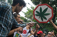 People smoke marijuana on a street during celebrations of the International Day of the Marijuana and for the legalization in Medellin, Colombia, May 5, 2012. Photo by Fredy Amariles/VIEWpress.
