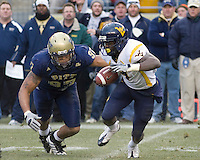 November 28, 2008. Pitt defensive lineman Jabaal Sheard (97) closes in on WVU running back Noel Devine. The Pitt Panthers defeated the West Virginia Mountaineers 19-15 on November 28, 2008 at Heinz Field, Pittsburgh, Pennsylvania.