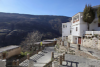 Capileira, with mountainous background, Poqueira gorge, Alpujarra, Andalucia, Southern Spain. Moorish influence is seen in the distinctive cubic architecture of the Sierra Nevada's Alpujarra region, reminiscent of Berber architecture in Morocco's Atlas Mountains. Photograph by Manuel Cohen.