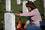 ARLINGTON, VA - NOVEMBER 11: Maria Rodriquez visits the grave of her son Ronald Rodriguez on Veteran's Day at Arlington National Cemetery on November 11, 2012 in Arlington, Virginia.
