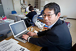 Toshiya Fujiwara, manager of the Operations Planning Office at the Ishinomaki branch of Japan Post Service Co., Ltd. sits at his desk in Ishinomaki, Miyagi Prefecture, Japan on Tuesday 24 May 2011..Prior to the March 11 quake and tsunamis, the office delivered around 95,000 items of post to some 85,000 households daily and was the headquarters for 15 delivery centres in surrounding towns and villages. .Photographer: Robert Gilhooly