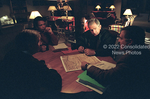 United States President George W. Bush meets with National Security Advisor Dr. Condoleezza Rice (left), White House Chief of Staff Andy Card (center) and Central Intelligence Agency (CIA) Director George Tenet (right) at Camp David, Maryland, Saturday, September 29, 2001..Mandatory Credit: Eric Draper - White House via CNP.
