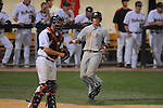 Arkansas-Little Rock's Brock Feldman (1) scores behind Mississippi catcher Taylor Hightower at Oxford-University Stadium in Oxford, Miss. on Wednesday, April 7, 2010. Arkansas-Little Rock won 9-6.
