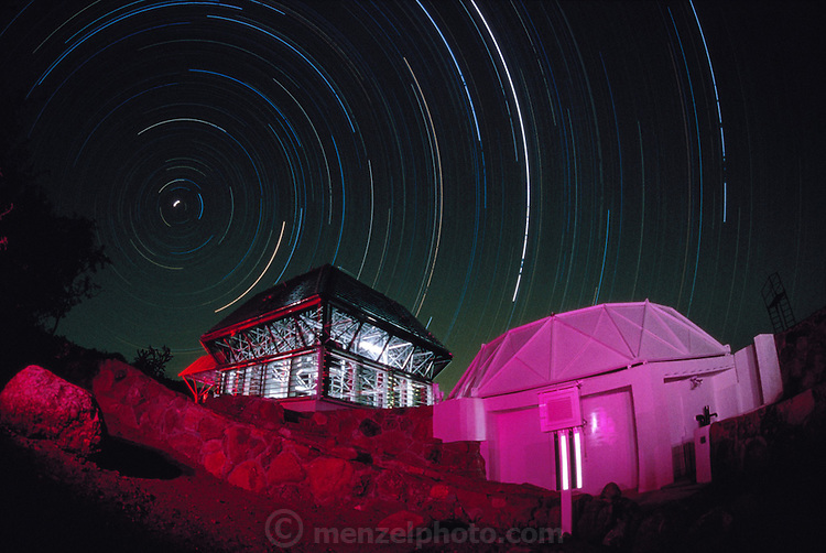 USA_SCI_BIOSPH_78_xs <br /> The Biosphere 2 Project&rsquo;s twenty-seven foot test module seen with star trails at night in a long exposure. The building to the right is an atmospheric chamber used to equalize the air pressure in the module. The Biosphere was a privately funded experiment, designed to investigate the way in which humans interact with a small self-sufficient ecological environment, and to look at the possibility of future planetary colonization. The $30 million Biosphere covers 2.5 acres near Tucson Arizona, and is entirely self-contained. The eight &lsquo;Biospherian&rsquo;s&rsquo; shared their air- and water- tight world with 3,800 species of plant and animal life over their two-year stay in the building, producing all of their own food and supporting the whole environment in five 'biomes'; agricultural, rain forest, savannah, ocean and marsh.  1986
