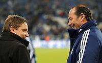 FUSSBALL   1. BUNDESLIGA   SAISON 2011/2012   22. SPIELTAG FC Schalke 04 - VfL Wolfsburg         19.02.2012 Gut gelaunt: Horst Heldt (li) und Trainer Huub Stevens (FC Schalke 04)