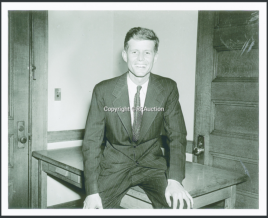 BNPS.co.uk (01202 558833)<br /> Pic: RRAuction/BNPS<br /> <br /> A 1952 Senatorial Campaign 'Official' Portrait of JFK.<br /> <br /> Incredibly-rare photos highlighting the first foray into politics for John F. Kennedy that would eventually cost him his life have come to light.<br /> <br /> The 100 black and white snaps show a youthful-looking JFK from 1946, when he was campaigning to become a US congressman for the first time.<br /> <br /> The tragic future president is seen during an oration lesson where he was given help by an expert with public speaking and posture.<br /> <br /> The 29-year-old is also depicted mingling with the public at an annual parade and as well as celebrating his first political victory - a congressional primary vote - in June 1946.<br /> <br /> The images are being sold by US-based RR Auction.