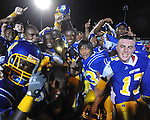Oxford High players hold the Crosstown Classic trophy following a win vs. Lafayette High at Bobby Holcomb Field in Oxford, Miss. on Thursday, August 30, 2012. Oxford High won 19-0.