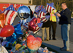 Gordon Corey, a former police officer signs a memory book near a memorial of flowers, balloons, and wreaths for four slain police officers at the Forza Coffee Shop  in Lakewood, Washington, USA, on 2 December  2009. Four Lakewood officers were gunned down during a morning meeting at a local coffee shop on 29 November 2009.  Jim Bryant Photo. ©2010. ALL RIGHTS RESERVED.