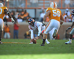 Ole Miss quarterback Nathan Stanley (12) picks up a bad snap in a college football game at Neyland Stadium in Knoxville, Tenn. on Saturday, November 13, 2010. Tennessee won 52-14.