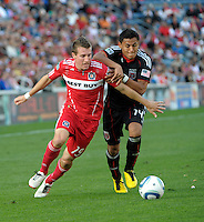 Chicago midfielder Corben Bone (19) battles for the ball with DC United midfielder Andy Najar (14).  The Chicago Fire tied DC United 0-0 at Toyota Park in Bridgeview, IL on Oct. 16, 2010.