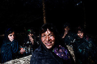 Afghan women  shelter from the sun beaneath a canopy at Maslakh Refugee Camp. More than 113, 000 people, displaced by drought and war, crowd the camp, 15 miles west of Herat. /Felix Features