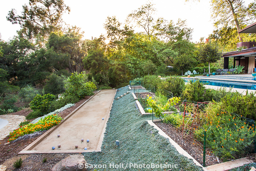 Tiered garden with bocce ball court and vegetable beds, Dymondia groundcover, Coyote House, SITES® residential home with sustainable garden Santa Barbara California, Susan Van Atta landscape architect, Ken Radtkey architect,