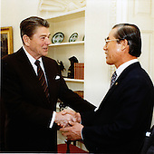 United States President Ronald Reagan, left, meets with YOON sung Min, Minister of National Defense of Korea, in the Oval Office of the White House in Washington, D.C. on Thursday, April 14, 1983..Mandatiry Credit: Karl H. Schumacher - White House via CNP