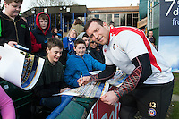 Henry Thomas of Bath Rugby signs autographs for supporters after the session. Bath Rugby Captain's Run on February 19, 2016 at the Recreation Ground in Bath, England. Photo by: Patrick Khachfe / Onside Images