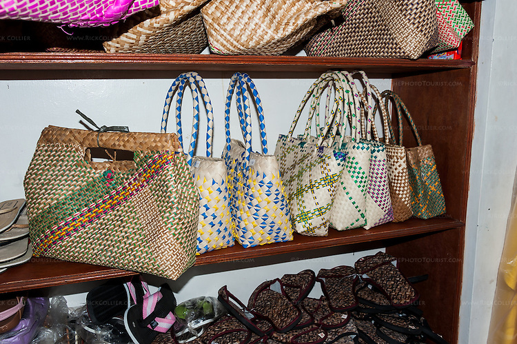 A variety of buri products are displayed in the front-room shop of Teming Oblena, chair-woman of the Sampaloc buri weaver's guild.  (Sampaloc, Quezon Province, the Philippines.)