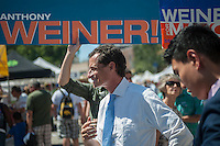 "NYC Mayoral candidate Anthony Weiner campaigns at the Brighton Beach Jubilee in the Brighton Beach neighborhood of Brooklyn in New York on Sunday, August 25, 2013. The neighborhood is sometimes colloquially named ""Little Odessa"" because of its popularity amongst Russian emigres and its proximity to the ocean. (© Richard B. Levine)"