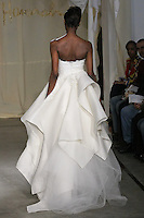 Model walks runway in a Birch wedding dress by Carol Hannah Whitfield, for the Carol Hannah Spring Summer 2012 Bridal collection runway show.
