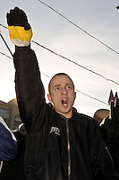 Moscow, Russia, 04/11/2005..Russian nationalsts give fascist salutes at a demonstration in central Moscow calling for an end to the &quot;occupation&quot; of Russia by illegal immigrants. The demonstration, organised by a variety of extremist nationalist groups led by the Eurasion Youth Union and the Movement Against Illegal Immigration, was held on the first People's Unity Day holiday, which has replaced the old holiday celebrating the Bolshevik Revolution.