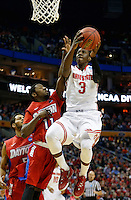 Ohio State Buckeyes guard Shannon Scott (3) sinks a basket against Dayton Flyers guard Scoochie Smith (11) in the first half of the second-round NCAA Tournament game between the Ohio State Buckeyes and the Dayton Flyers at the First Niagara Center, Thursday afternoon, March 20, 2014. As of half time the Dayton Flyers led the Ohio State Buckeyes 33 - 30. (The Columbus Dispatch / Eamon Queeney)