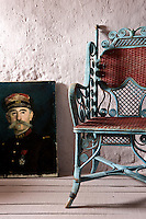 In this attic bedroom the walls and floorboards have been painted the same dusty rose-pink; the cane-backed chair is Napoleon III
