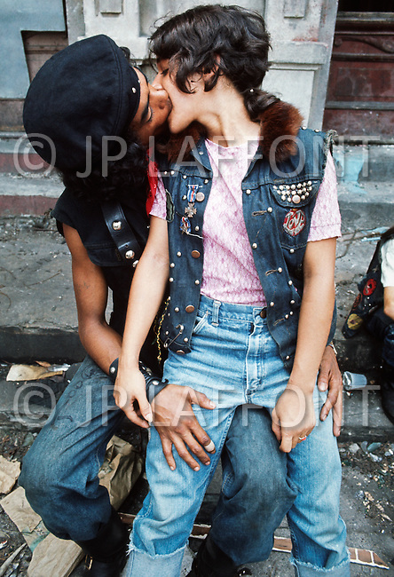 July 1972, The Bronx, New York City, New York State, USA --- Members of the New York street gang Savage Skulls. The trademark of the, primarily Puerto Rican, gang was a sleeveless denim jacket with a skull and crossbones design on the back. Based around Fox Street, in the popular South Bronx neighbourhood, the gang declared war on the drug dealers that operated in the area. Running battles were frequent with rival gangs Seven Immortals, and Savage Nomads. --- Image by © JP Laffont/Sygma/Corbis