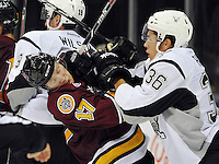 San Antonio Rampage's Jonathan Racine, right, scrums with Chicago Wolves' Sergey Andronov during the third period of an AHL hockey game between the Chicago Wolves and the San Antonio Rampage, Friday, Oct. 4, 2013, in San Antonio. Chicago won 2-1. (Darren Abate/M3D14.com)