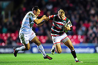 Matthew Tait of Leicester Tigers fends Dan Carter of Racing 92. European Rugby Champions Cup match, between Leicester Tigers and Racing 92 on October 23, 2016 at Welford Road in Leicester, England. Photo by: Patrick Khachfe / JMP