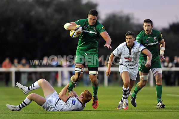 Dan Leo takes on the Bristol defence. Pre-season friendly match, between London Irish and Bristol Rugby on August 22, 2014 at Hazelwood in Middlesex, England. Photo by: Patrick Khachfe / JMP